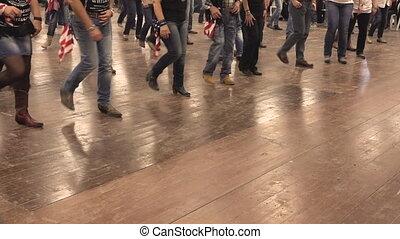 People dancing a western choreography at a folk festival -...
