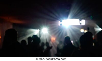 People dancing at the party. Unrecognizable silhouette crowd in nightclub with disco light