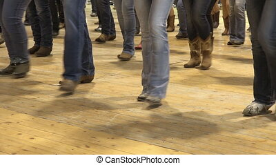 People dancing bluegrass music, line dance at a folk event,...