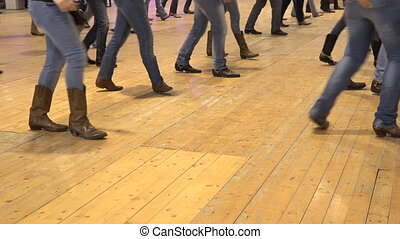 People dancing country line dance at a folk event, cowboy USA style