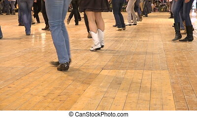 Men and women doing choreography American horse festival. Music tradition jeans skirt boots and flag