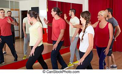 People dancing in a gym