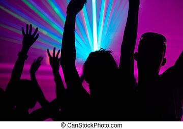 People dancing in club with laser - Silhouettes of dancing ...