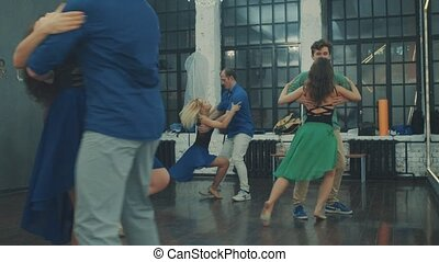 People dancing in the hall - Several couples dancing in the...