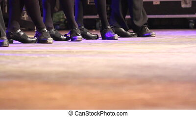 People dancing Irish dance line at folk festival - Two rows...
