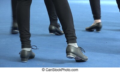 People dancing together tap dance at musical festival....