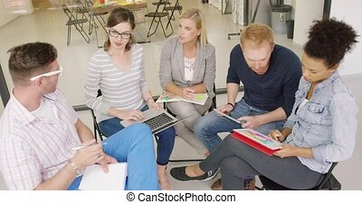 People discussing work plans - Group of people in casual...