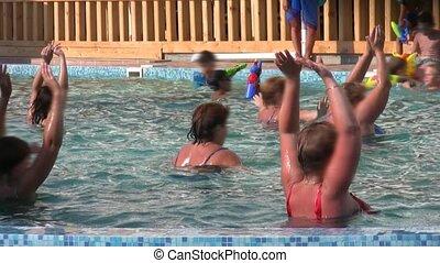 people doing aqua aerobic in swimming pool