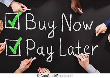 People Drawing Buy Now Pay Later Concept On Chalkboard