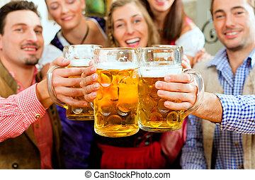 People drinking beer in Bavarian pub - Inn or pub in Bavaria...