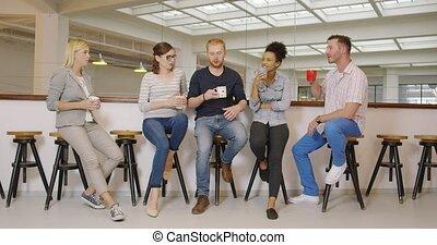 People drinking coffee during break - Group of people in...