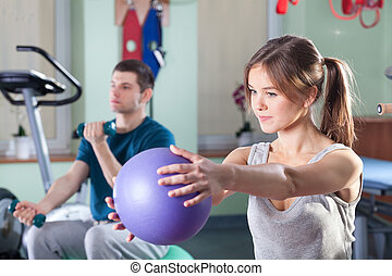 People during physical exercises at rehabilitation room