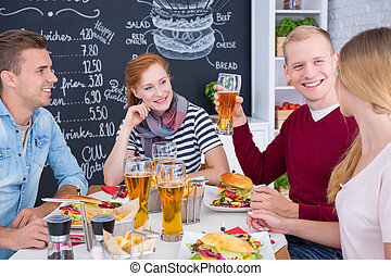 People eating burgers