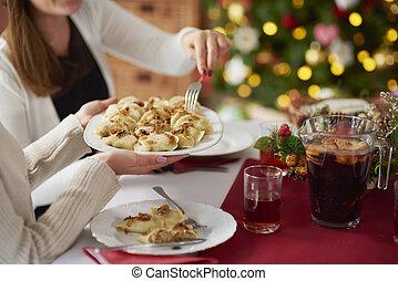 People eating dumplings on Christmas eve