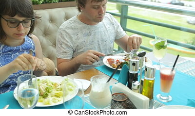 People eating in cafe