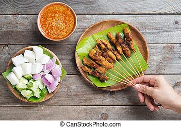 People eating satay