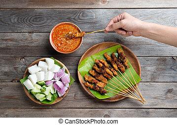 People eating sate
