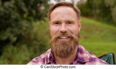 portrait of happy smiling man with beard - people, emotion ...