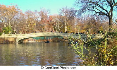 People enjoy sunny autumn day in New York Central park