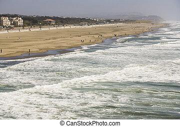 people enjoy the waves at Ocean Beach