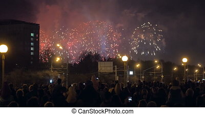 People enjoying fireworks in the city
