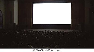 People enjoying the film in cinema