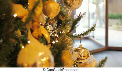 A guest enters into the hotel for the check-in through a sliding door. Christmas time. Holiday theme for your creative concept.