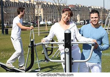 People exercising in a public park