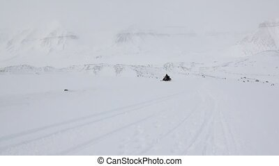 People expedition on snowmobile in North Pole Spitsbergen...