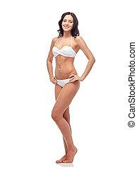 happy young woman in white bikini swimsuit