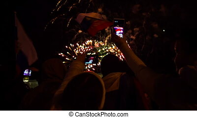 People Filming Fireworks Using Smartphones - In the frame ...