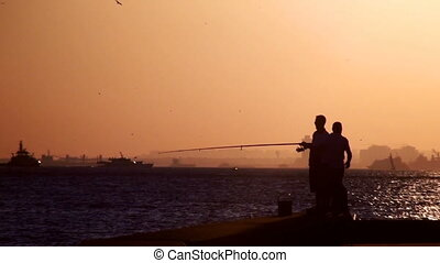 People fishing in sunset