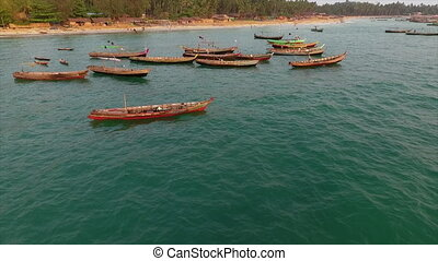 People, fishing nets and other items on two boats - A birds...