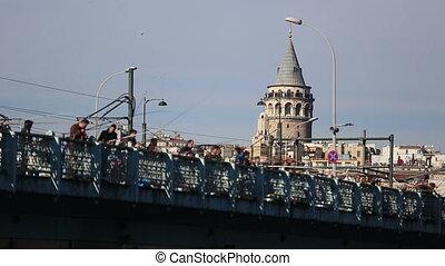 people fishing on the bridge