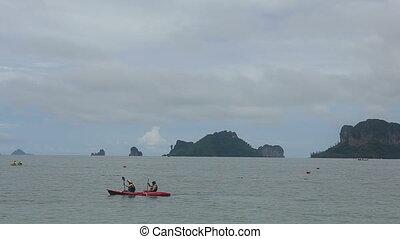 people floating in a kayak azure sea