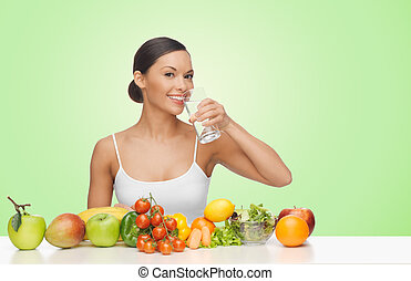 woman with fruits and vegetables drinking water