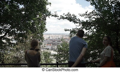 People friends view of the city from a height