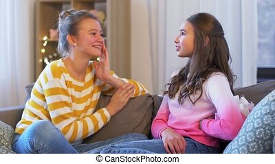 teenage girl giving present to her friend at home - people, ...