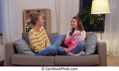 happy teenage girls gossiping at home - people, friendship ...