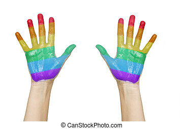 palms of human hands painted in rainbow colours