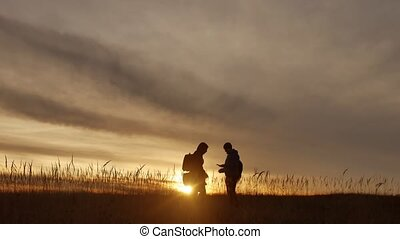 people go group travel of tourists field nature of a sunset...
