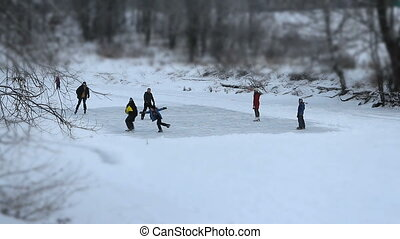 people go ice skating, ice rink on the winter river