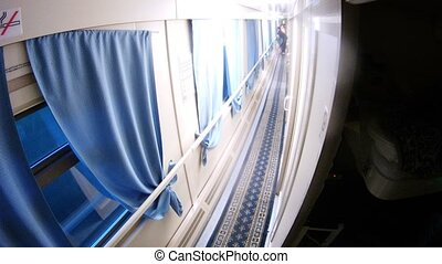 People go in corridor of compartment wagon, time lapse