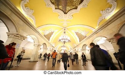 People go in different directions in in Komsomolskaya station of Moscow subway, back view