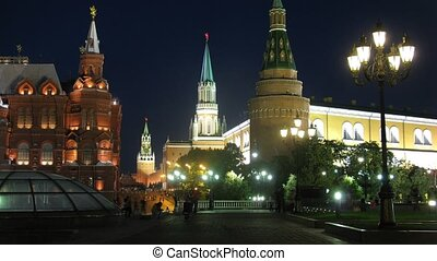 People go in evening in front of Historical museum and Kremlin