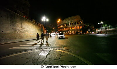 People go through pedestrian crossing near Colosseum