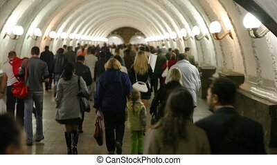 People goes in subway corridor. - People goes in illuminated...