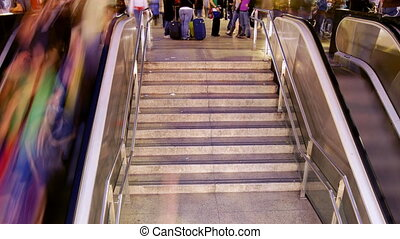 people going up and down a subway entrance in barcelona spain