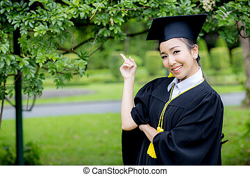 people, graduation pointing finger with something, education concept