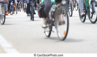 People group of cyclists go to the city